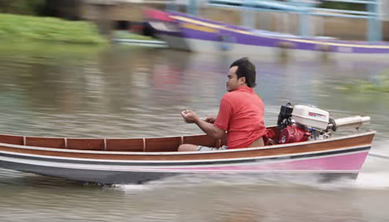 Boatman on the Chao Phraya River